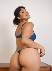 See sexy Latina Laurie pull herself out of her tight little dress and shows off her sexy new blue lingerie. Hey curvy ass and dark skin truly compleme