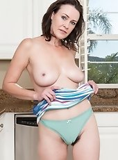 Hairy woman Veronica Snow is in the kitchen in the afternoon when she gets hot and strips out of her clothes showing off her teal panties and then she