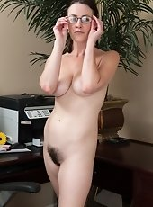 Veronica Snow is a sexy brunette business woman who gets hot and horny at work and strips naked. She shows off her hairy pussy and then slides her lon