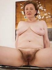 Hairy woman Romana Sweet just can't keep her hands off her hairy body. She was all set to leave the house when she suddenly got really horny and